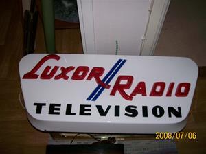 Såld. 182. Luxor//Radio Television. Typ: Väggmonterad reklamskylt för utomhusbruk. Har suttit vid Klinte Radio och TV. Nr: 182. Fotonr: 100_1305.