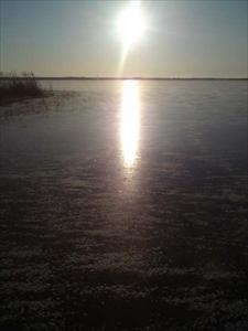 Sol över isen